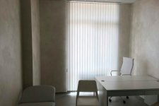 Вертикальные жалюзи из ткани для кабинета